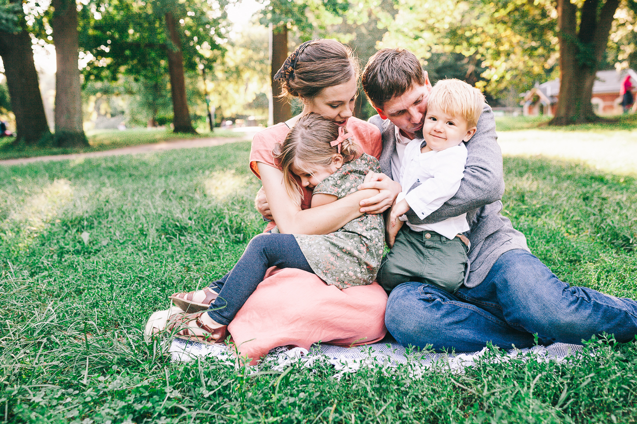 family snuggling on grass in Prospect Park Family photo session 1750
