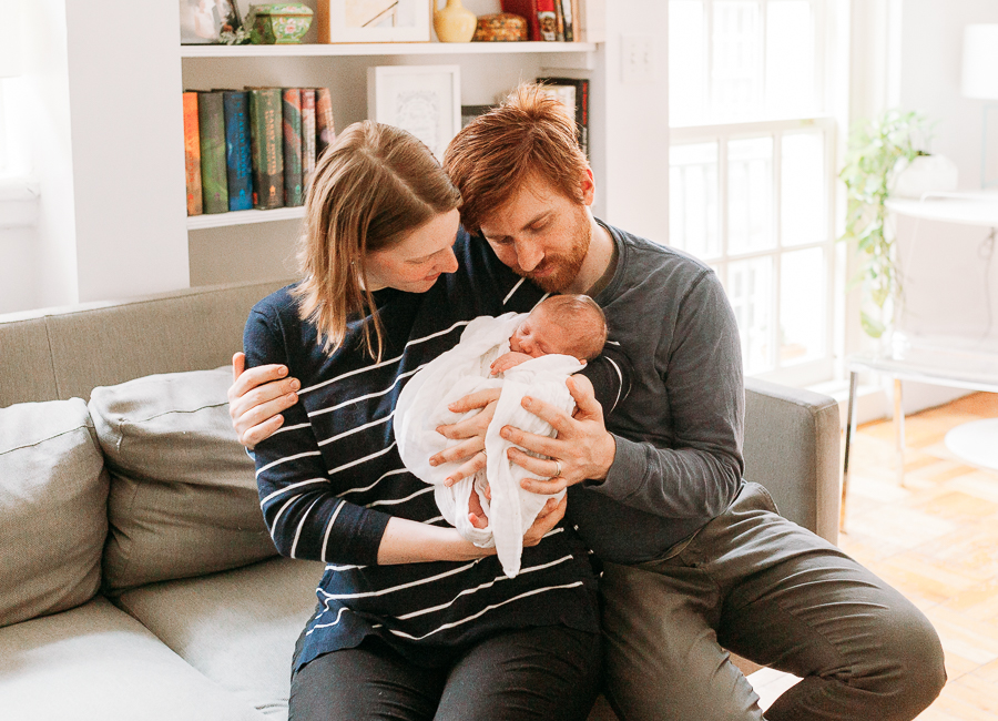mom dad and baby at newborn session charis elisabeth 8292